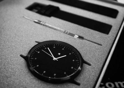 fancy black watch in foam inside a rigid box